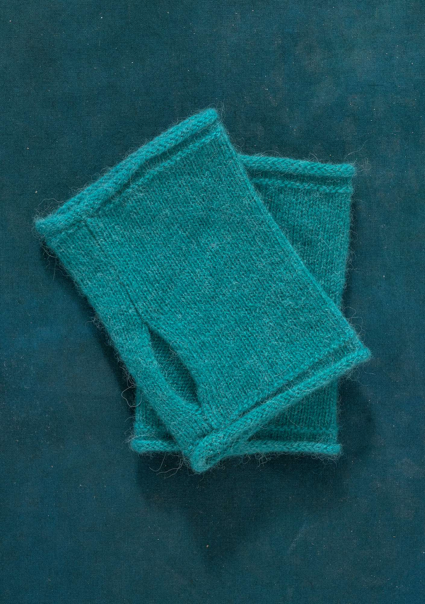 Knitted fingerless gloves aqua green